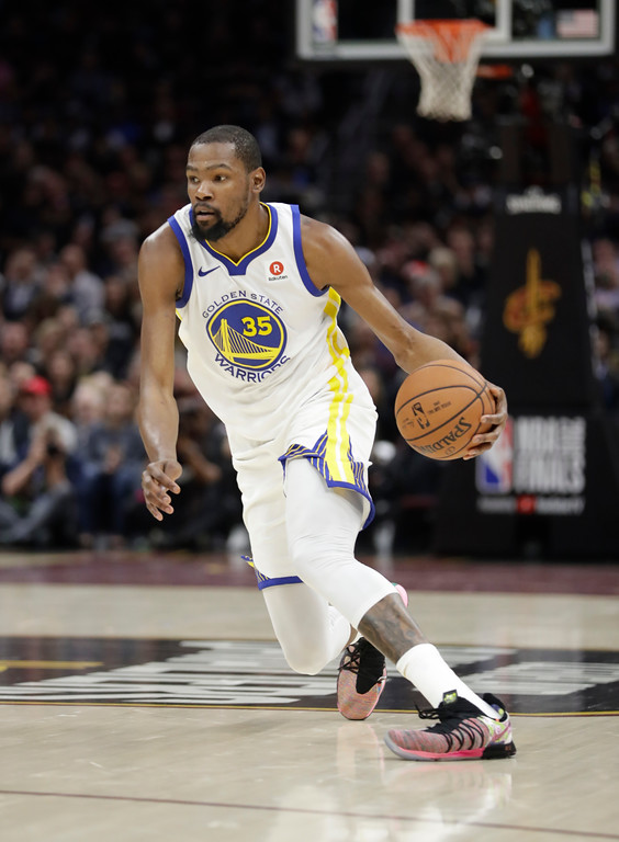 . Golden State Warriors\' Kevin Durant dribbles in the first half of Game 3 of basketball\'s NBA Finals after the game, Wednesday, June 6, 2018, in Cleveland. (AP Photo/Tony Dejak)