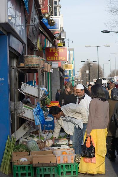 People shopping on Whitechapel Road, London, United Kingdom