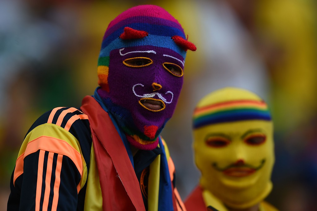. Colombia\'s fans wear knitted masks before a Group C football match between Colombia and Ivory Coast at the Mane Garrincha National Stadium in Brasilia during the 2014 FIFA World Cup on June 19, 2014.   AFP PHOTO / EITAN  ABRAMOVICH/AFP/Getty Images