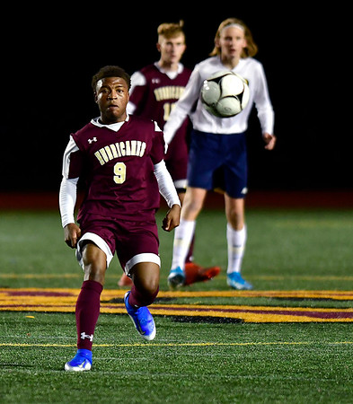 10/24/2019 Mike Orazzi | StaffrNew Britain's Shevon Teraille (9) during Thursday night's boys soccer with Simsbury at Veterans Stadium in New Britain.