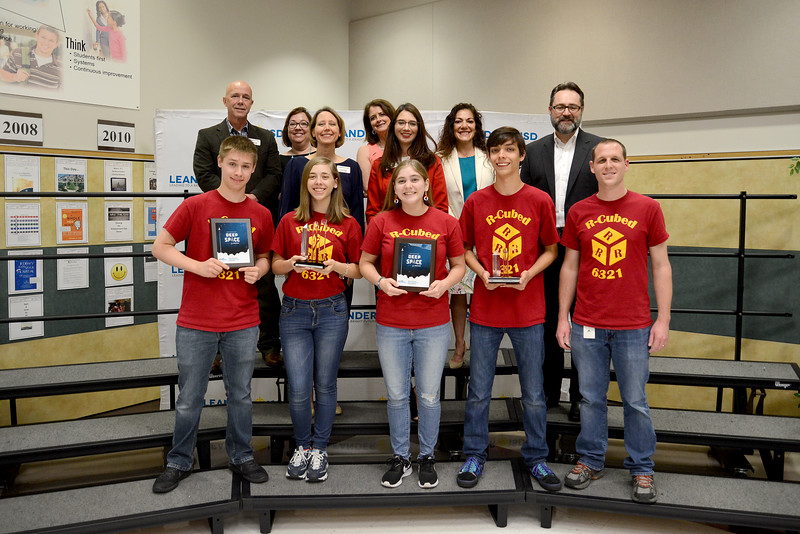 Rouse High School's R-Cubed robotics team, recognized for advancing to the FIRST Robotics World competition in the FRC division.