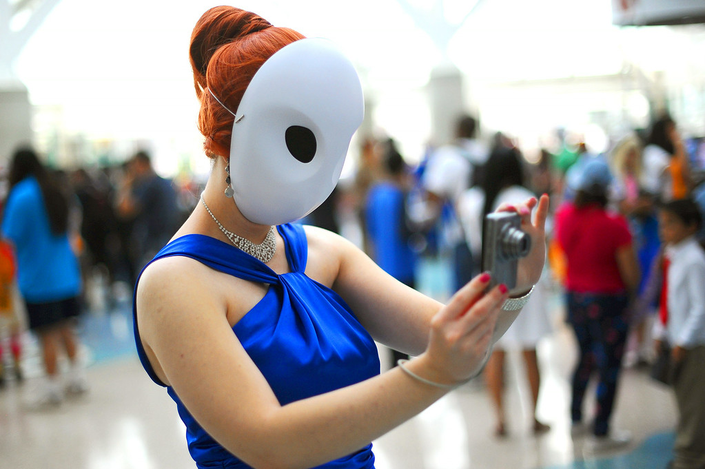 . Anastasia Varisco takes photos of other cosplaying fans during Anime Expo 2014 at the Los Angeles Convention Center July 3, 2014.  The expo, which runs from July 3-6, is expect to draw 200,000 Japanese animation and pop culture fans.(Andy Holzman/Los Angeles Daily News)