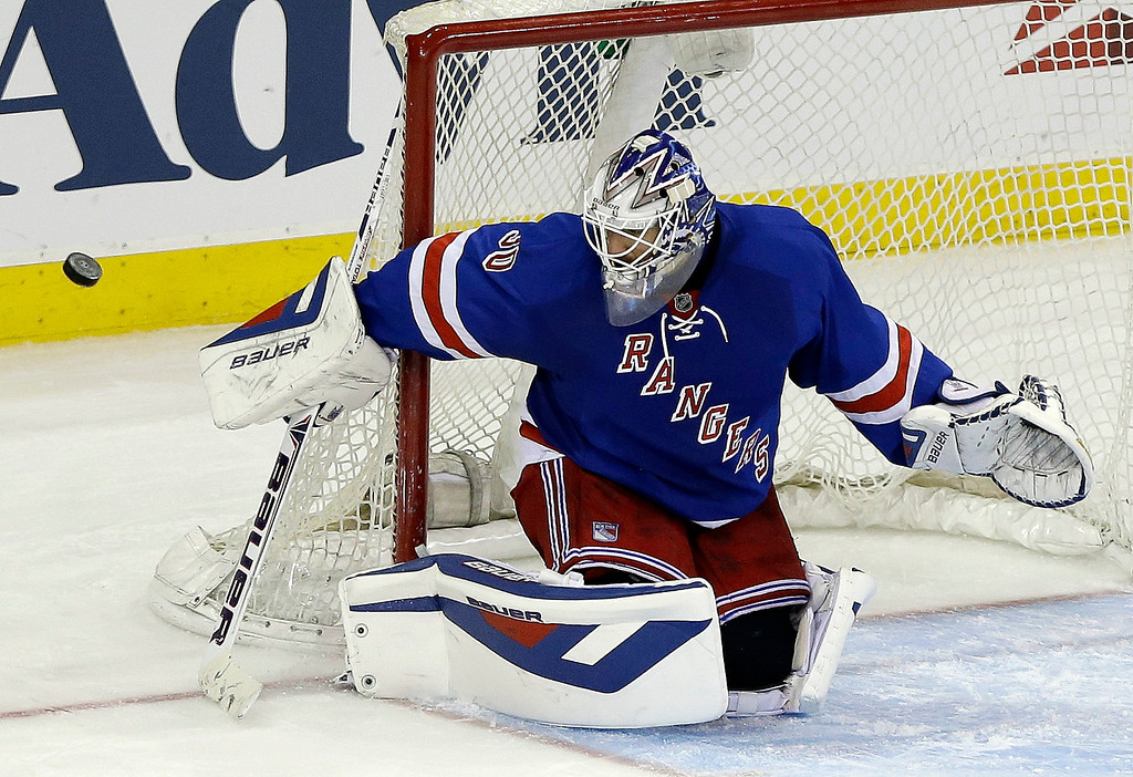 . New York Rangers goalie Henrik Lundqvist, of Sweden, stops a shot-on-goal during the third period of an NHL hockey game against the Colorado Avalanche, Tuesday, Feb. 4, 2014, in New York. The Rangers won the game 5-1. (AP Photo/Frank Franklin II)