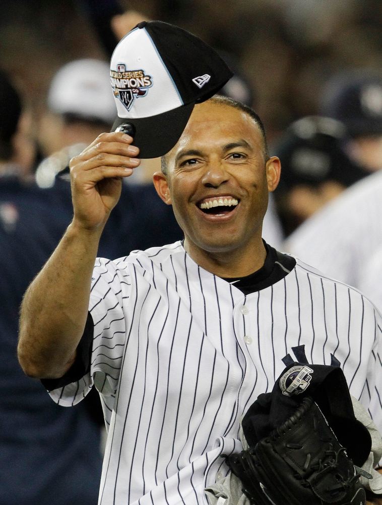 . New York Yankees\' Mariano Rivera holds up a World Champion cap after winning the Major League Baseball World Series against the Philadelphia Phillies Wednesday, Nov. 4, 2009, in New York. (AP Photo/David J. Phillip)