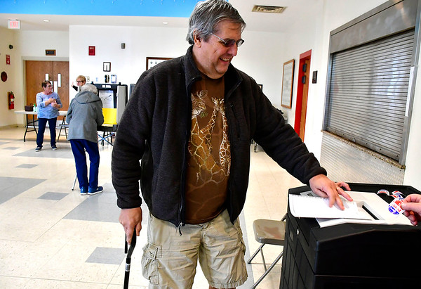 4/30/2019 Mike Orazzi | Staff Mark Fioravanti places his ballot into a counter at the Plainville Fire Station during Tuesday's budget vote.