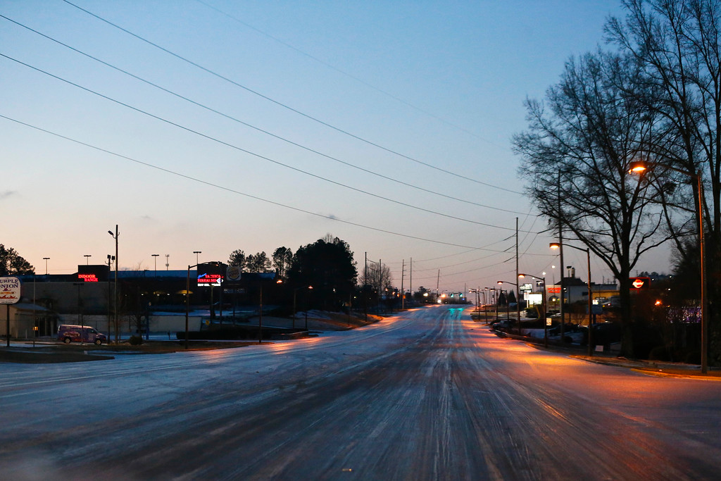 . Ice covers the roads, Saturday, Jan. 7, 2017, in Hoover, Ala. (AP Photo/Brynn Anderson)