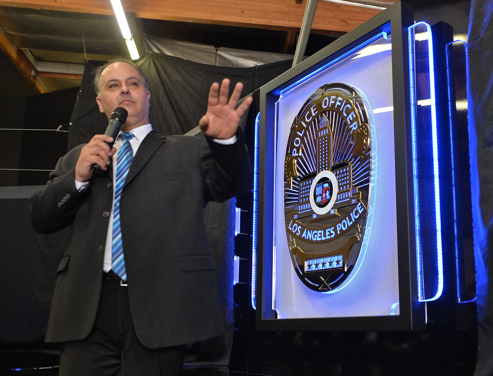 . The Los Angeles Police Protective League and the Eagle & Badge Foundation unveiled new End of Watch Memorial Wall featuring the names of the 206 officers who have died in the line of duty. The 60 ft. wide and 9 ft tall wall was made at Commemorative Badge Company in Gardena where it was unveiled. Wall designer Timothy Lampros.       Photo by Robert Casillas / Daily Breeze
