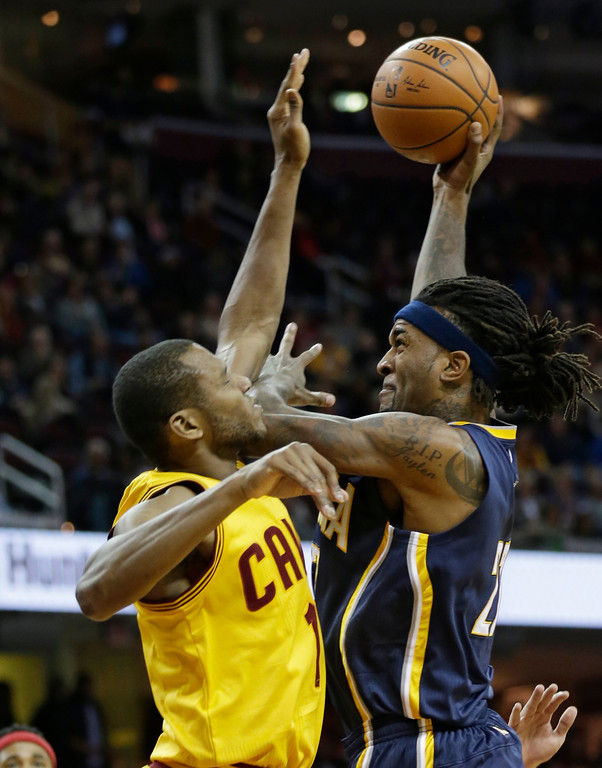 . Cleveland Cavaliers\' James Jones, left, fouls Indiana Pacers\' Jordan Hill in the first half of an NBA preseason basketball game, Thursday, Oct. 15, 2015, in Cleveland. (AP Photo/Tony Dejak)