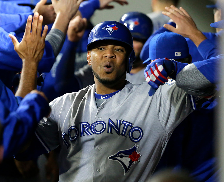 . Toronto Blue Jays\' Edwin Encarnacion is greeted in the dugout after he hit a two-run home run in the third inning of a baseball game against the Seattle Mariners, Monday, Sept. 19, 2016, in Seattle. (AP Photo/Ted S. Warren)
