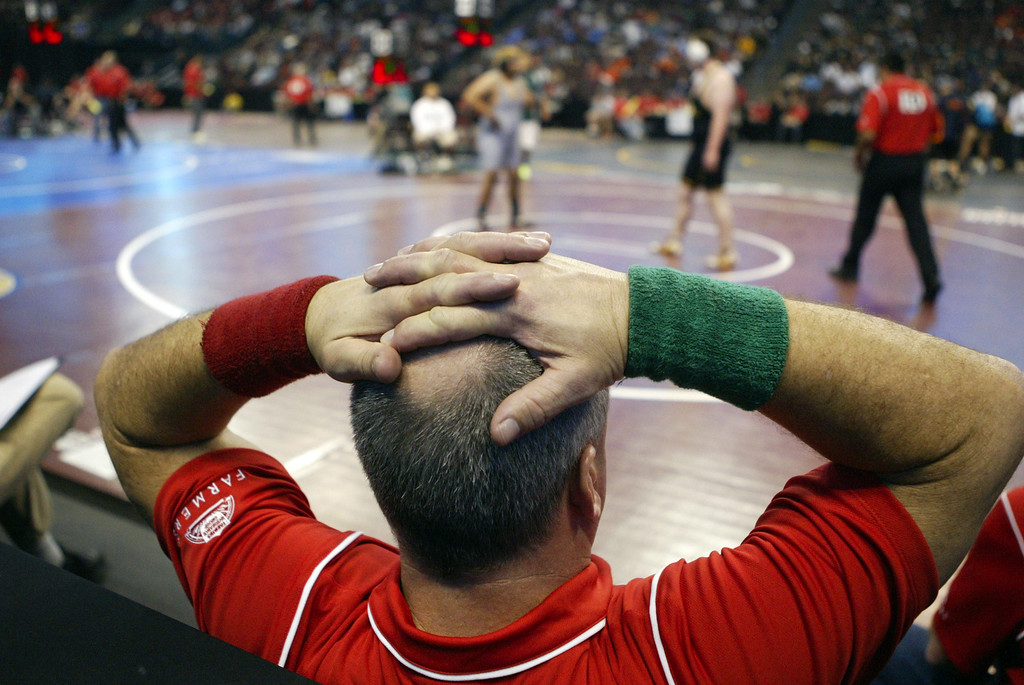 . An official relaxes between matches during the California Interscholastic Federation wrestling championships in Bakersfield, Calif., on Friday, March 1, 2013. (Anda Chu/Staff)