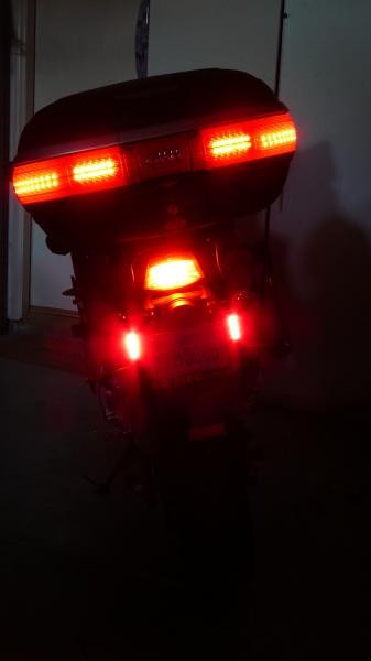 These LEDs are not as bright as the hyperlights, but are still as bright as the tail & brake lights. The real benefits come from the greater surface area that is illuminated and the height of the illumination.