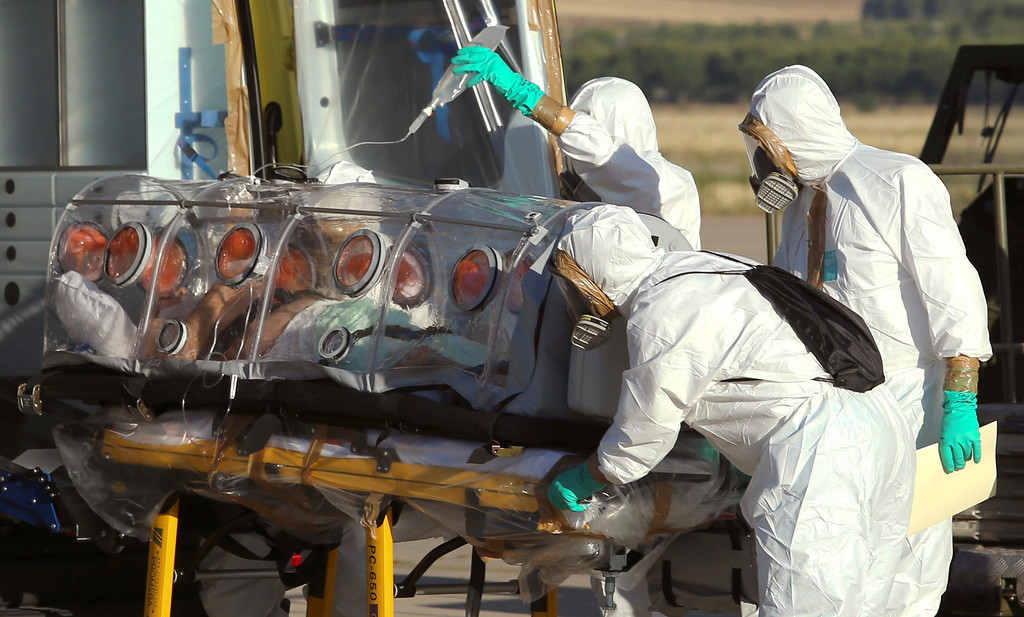 . In this photo provided by the Spanish Defense Ministry, aid workers and doctors transfer Miguel Pajares, a Spanish priest who was infected with the Ebola virus while working in Liberia, from a plane to an ambulance as he leaves the Torrejon de Ardoz military airbase, near Madrid, Spain, Thursday, Aug. 7, 2014. (AP Photo/Spanish Defense Ministry, File)