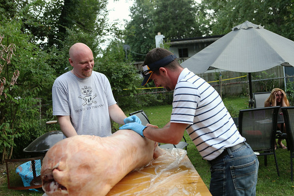 A pig was roasted (heads up - some of these pics are a bit graphic)