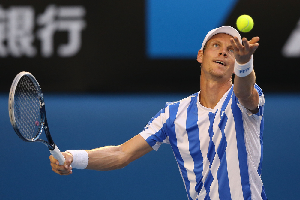 . Tomas Berdych of the Czech Republic serves in his semifinal match against Stanislas Wawrinka of Switzerland during day 11 of the 2014 Australian Open at Melbourne Park on January 23, 2014 in Melbourne, Australia.  (Photo by Michael Dodge/Getty Images)