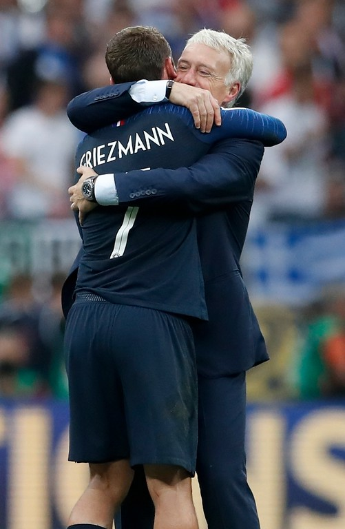 . France head coach Didier Deschamps hugs Antoine Griezmann at the end of the final match between France and Croatia at the 2018 soccer World Cup in the Luzhniki Stadium in Moscow, Russia, Sunday, July 15, 2018. France won 4-2. (AP Photo/Petr David Josek)