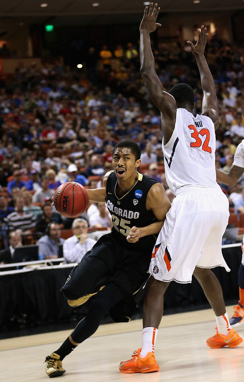 . AUSTIN, TX - MARCH 22:  Spencer Dinwiddie #25 of the Colorado Buffaloes dribbles around Nnanna Egwu #32 of the Illinois Fighting Illini during the second round of the 2013 NCAA Men\'s Basketball Tournament at The Frank Erwin Center on March 22, 2013 in Austin, Texas.  (Photo by Ronald Martinez/Getty Images)