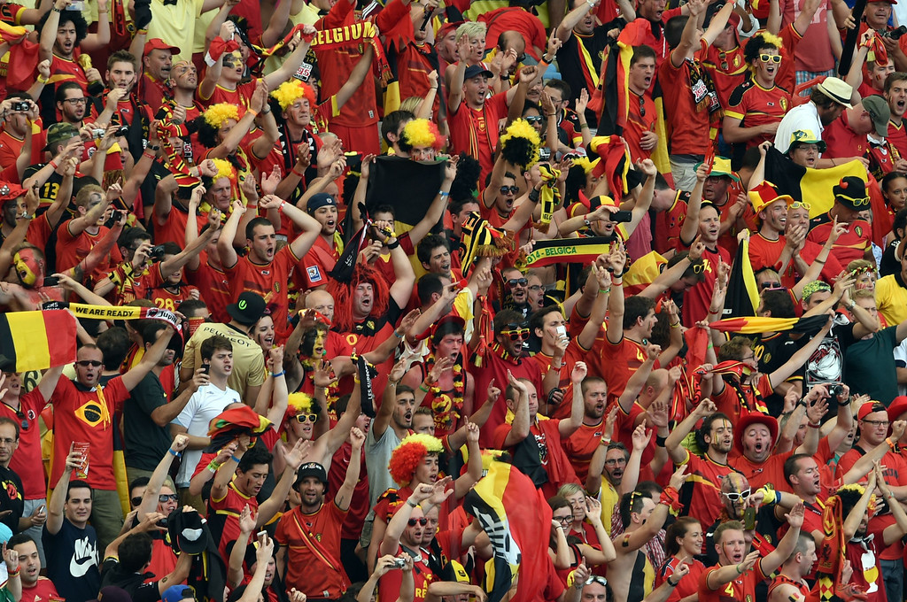 . Belgian supporters celebrate after their victory in the Group H football match between Belgium and Russia at The Maracana Stadium in Rio de Janeiro on June 22, 2014, during the 2014 FIFA World Cup. AFP PHOTO / YASUYOSHI CHIBA