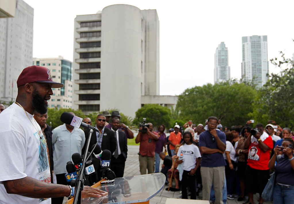 . Tracy Martin, father of Trayvon Martin, speaks to the crowd during a rally for his son in Miami, Florida July 20, 2013. Trayvon Martin\'s parents were due to lead demonstrations in New York and Miami on Saturday, as protesters across the country rallied to express anger over the acquittal of George Zimmerman, the man who shot and killed the unarmed black teenager. REUTERS/Andrew Innerarity