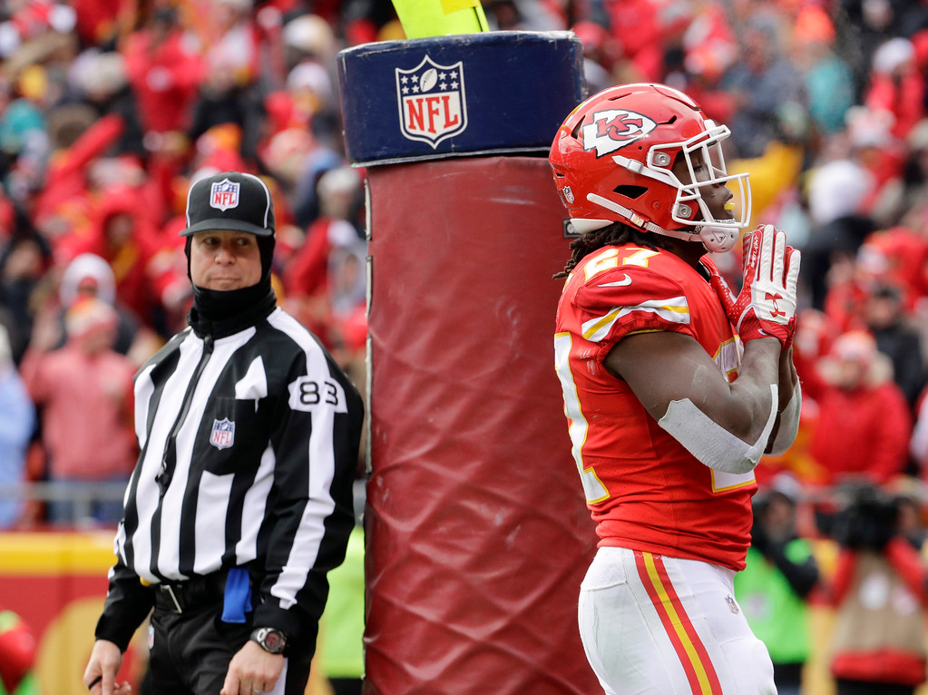 . Kansas City Chiefs running back Kareem Hunt (27) reacts after scoring a touchdown against the Miami Dolphins during the first half of an NFL football game in Kansas City, Mo., Sunday, Dec. 24, 2017. (AP Photo/Charlie Riedel)