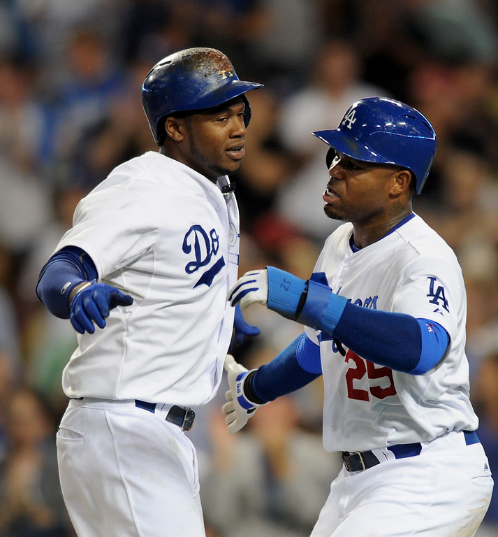 . The Dodgers Hanley Ramirez, left, is congratulated by  Carl Crawford after slugging a two-run homer in the fourth inning against the Red Sox Friday, August 23, 2013. (Michael Owen Baker/L.A. Daily News)