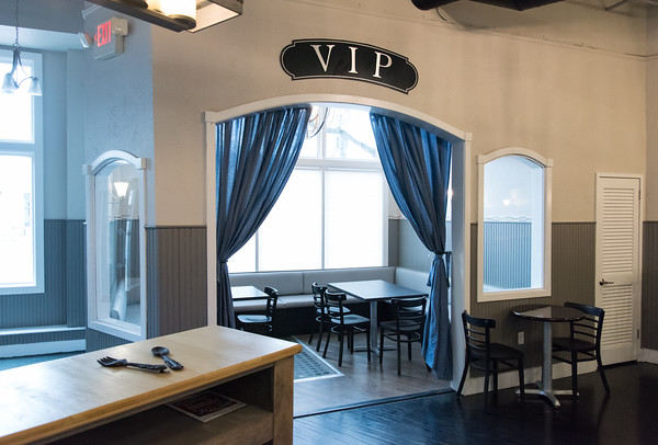 04/19/18 Wesley Bunnell | Staff Mofongo owner Vincent Placeres is set to open a new restaurant named The Kitchen which located at 136 Main St. A look at the hostess counter with one of the VIP rooms facing Main St.
