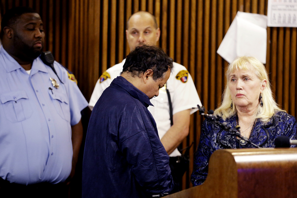 Description of . Ariel Castro, left, talks with public defender Kathleen DeMetz during his arraignment in Cleveland Municipal court Thursday, May 9, 2013, in Cleveland. Ariel Castro was charged with four counts of kidnapping and three counts of rape.  Ariel Castro was charged while his brothers, Pedro and Onil Castro, were held but faced no immediate charges. (AP Photo/David Duprey)