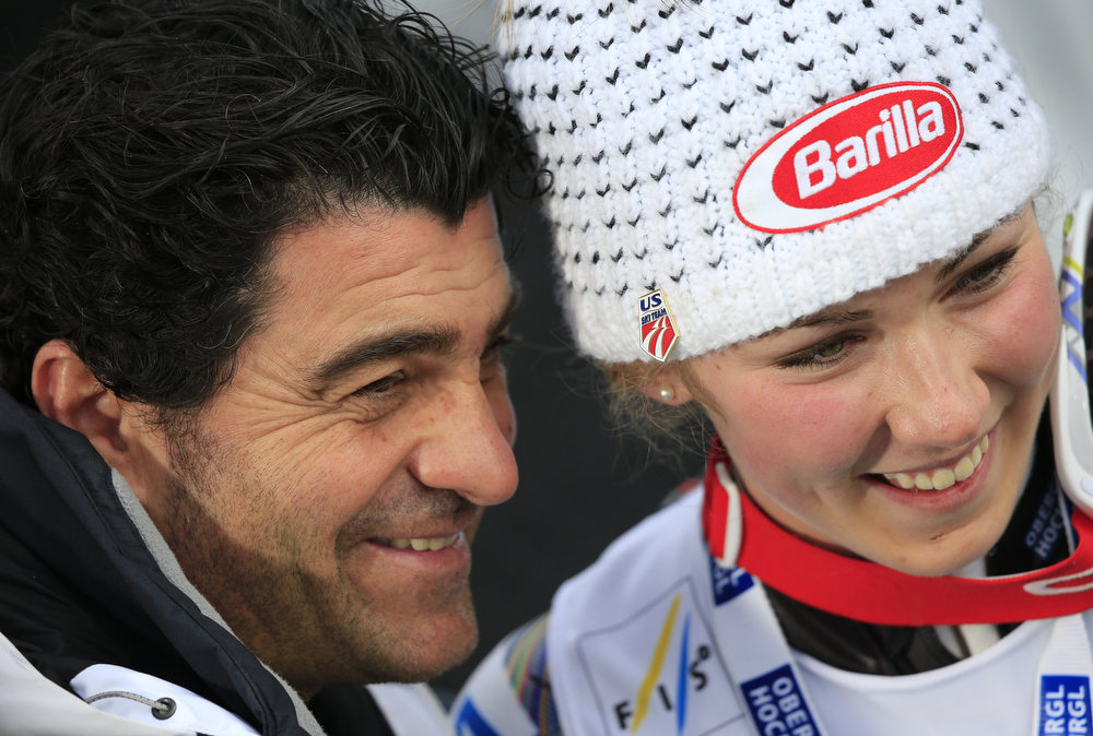 Description of . US Mikaela Shiffrin (R) poses with Italian skiing legend Alberto Tomba after winning the women's slalom at the 2013 Ski World Championships in Schladming, Austria on February 16, 2013.  ALEXANDER KLEIN/AFP/Getty Images