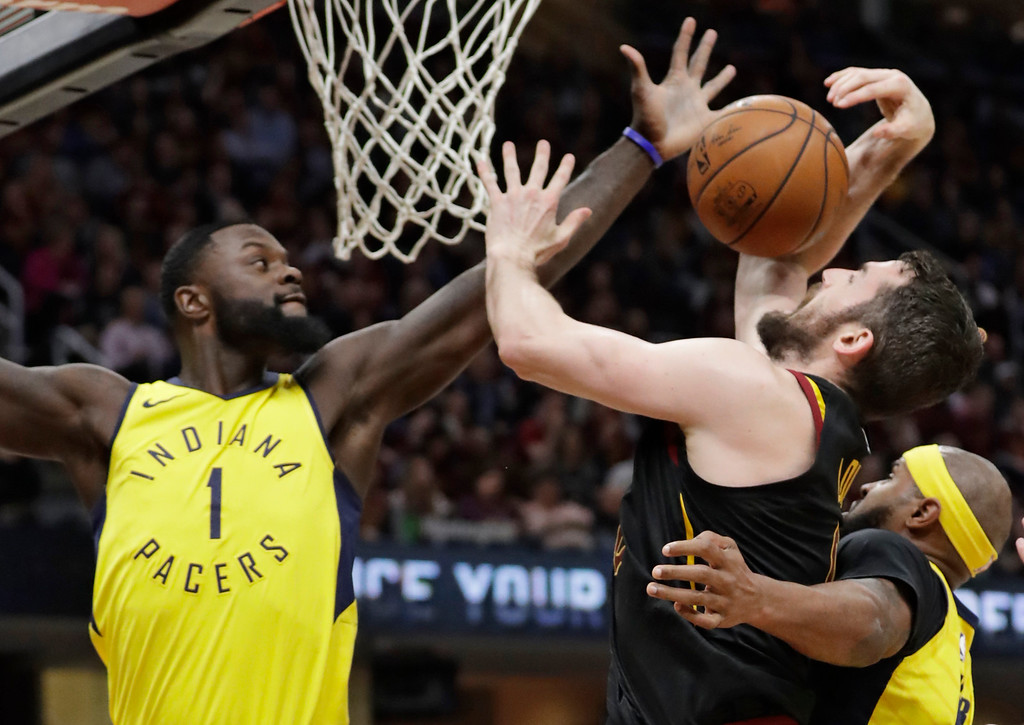 . Indiana Pacers\' Lance Stephenson, left, knocks the ball loose from Cleveland Cavaliers\' Kevin Love in the first half of Game 5 of an NBA basketball first-round playoff series, Wednesday, April 25, 2018, in Cleveland. (AP Photo/Tony Dejak)