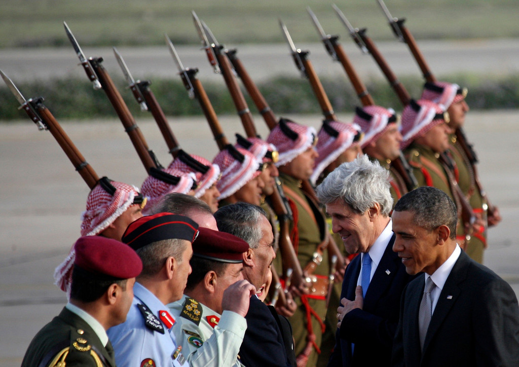 . U.S. President Barack Obama (R) and U.S. Secretary of State John Kerry (2nd R) are  greeted by Jordanian officials upon their arrival at Amman airport March 22, 2013.   REUTERS/Ali Jarekji