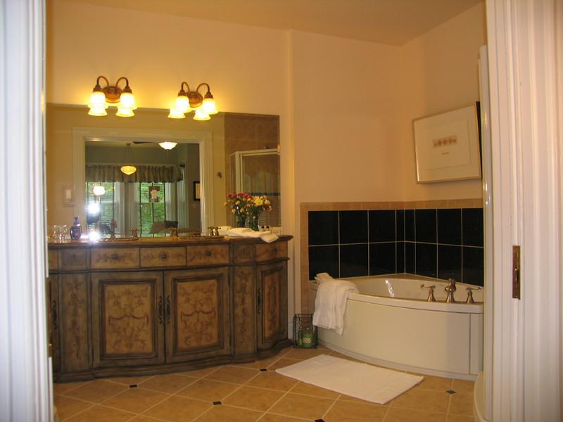 Warren room. Bathroom behind pocket doors.