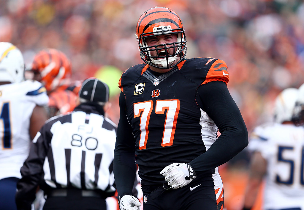 . Tackle Andrew Whitworth #77 of the Cincinnati Bengals reacts against the San Diego Chargers during a Wild Card Playoff game at Paul Brown Stadium on January 5, 2014 in Cincinnati, Ohio.  (Photo by Andy Lyons/Getty Images)