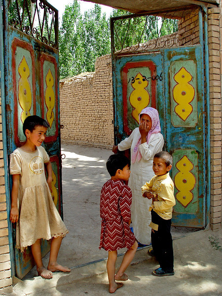 Family at gate to courtyard in village near Kashgar DSC01991.jpg