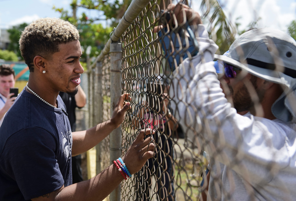 . Cleveland Indians All-Star shortstop Francisco Lindor visits his former grammar school, Villa Marina Elementary School, to lead a special baseball clinic for approximately 250 students in Gurabo, Puerto Rico, Monday, April 16, 2018. Next Tuesday and Wednesday, the Cleveland Indians and the Minnesota Twins will meet in a two-game series at Hiram Bithorn Stadium in San Juan. (AP Photo/Carlos Giusti)