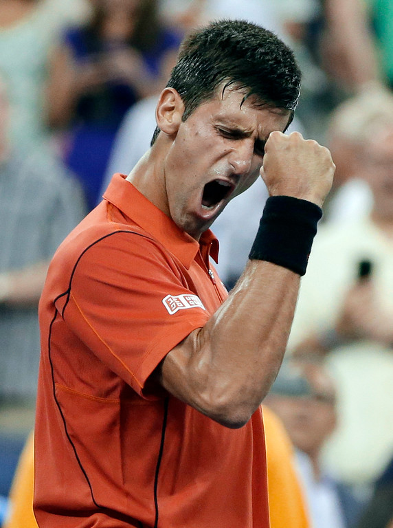 . Novak Djokovic, of Serbia, reacts after defeating Ricardas Berankis, of Lithuania, in a first round of the U.S. Open tennis tournament Tuesday, Aug. 27, 2013, in New York. (AP Photo/Darron Cummings)