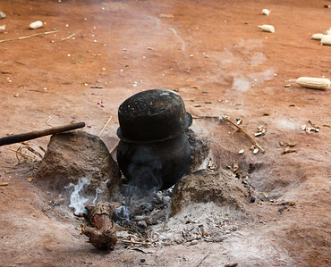 Traditional cooking fire in IDP camp. Northern Uganda. 2008.