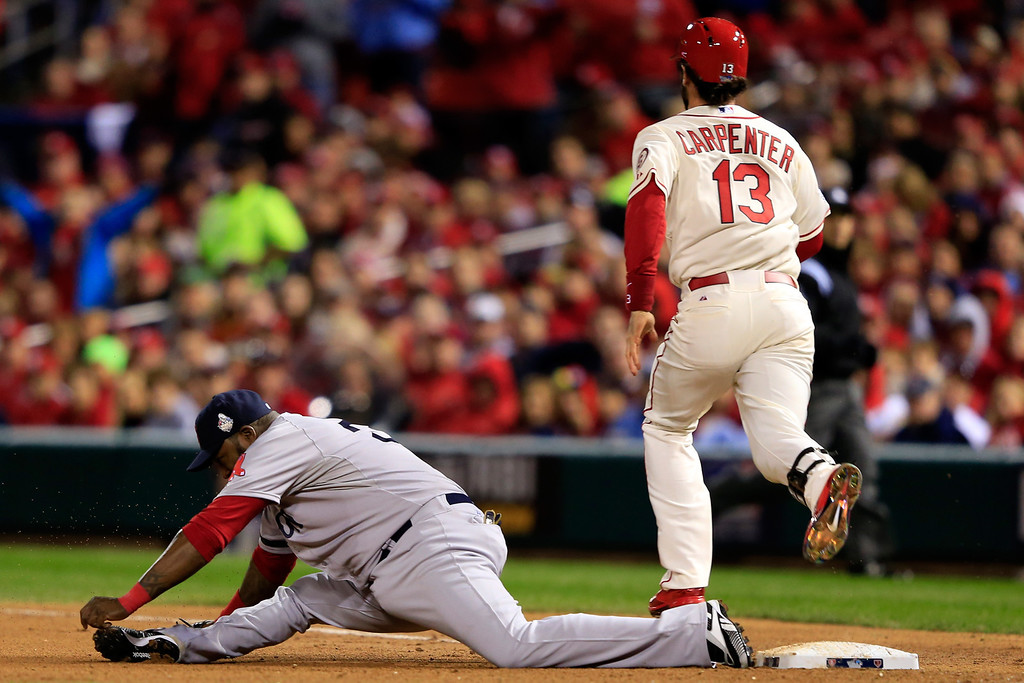 . ST LOUIS, MO - OCTOBER 26:  David Ortiz #34 of the Boston Red Sox reacts as he misses a play at first on a single hits a by Matt Carpenter #13 of the St. Louis Cardinals in the seventh inning during Game Three of the 2013 World Series against the St. Louis Cardinals at Busch Stadium on October 26, 2013 in St Louis, Missouri.  (Photo by Jamie Squire/Getty Images)