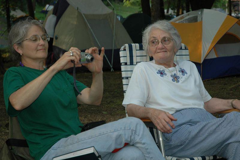 Grandma watches Mom compose a shot.