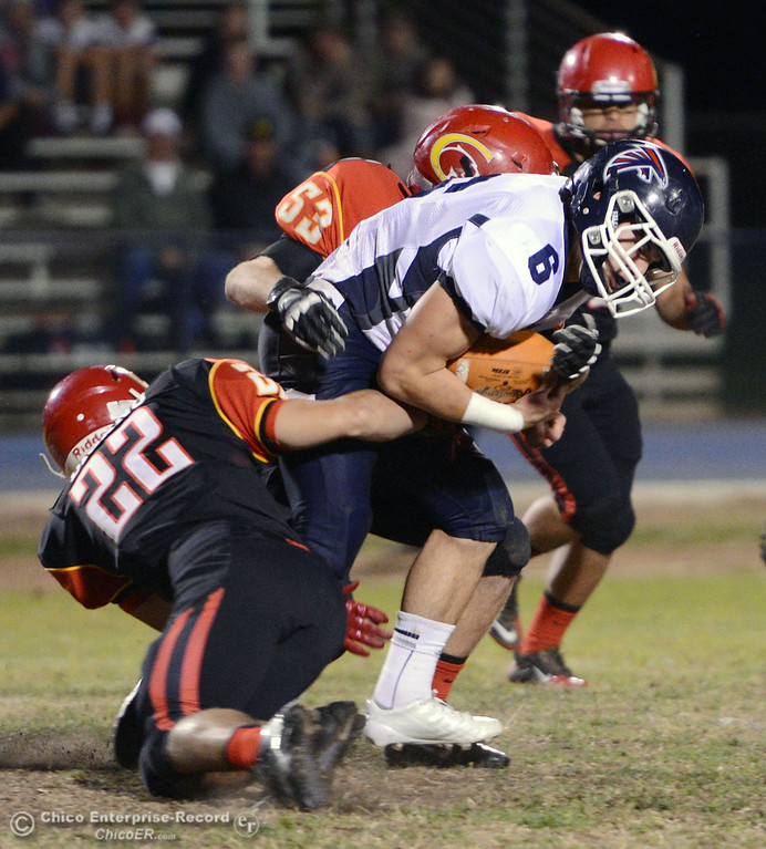 . Chico High\'s #22 Paolo DiSano (left) and #53 Cameron Power (top) tackle against Central Valley High\'s #6 Connor Silveria (right) in the first quarter of their football game at Asgard Yard Friday, September 27, 2013, in Chico, Calif.  (Jason Halley/Chico Enterprise-Record)