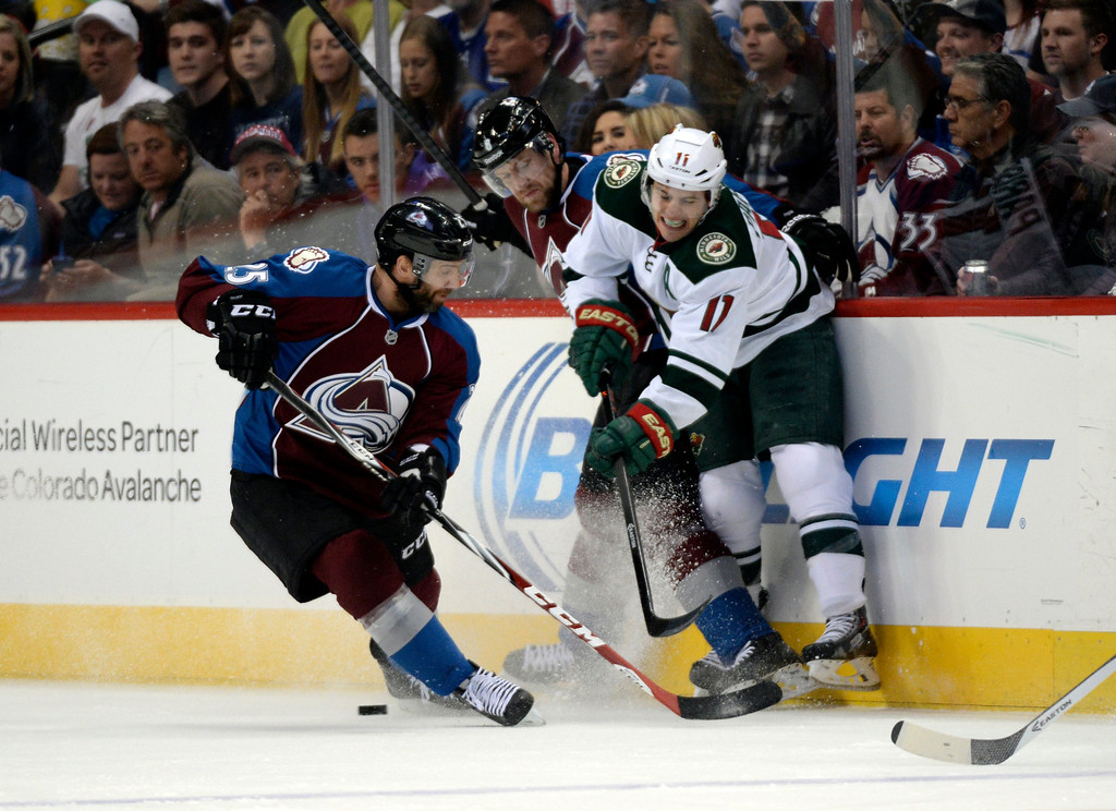 . DENVER, CO - APRIL 26: Minnesota Wild left wing Zach Parise (11) is forced to get rid of the puck as Colorado Avalanche defenseman Jan Hejda (8) and Colorado Avalanche center Maxime Talbot (25) pressure during the first period of action. The Colorado Avalanche hosted the Minnesota Wild in the fifth round of the Stanley Cup Playoffs at the Pepsi Center in Denver, Colorado on Saturday, April 26, 2014. (Photo by John Leyba/The Denver Post)