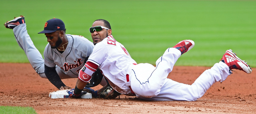 . Cleveland Indians\' Edwin Encarnacion, right, is safe at second base on an RBI-double as Detroit Tigers\' Niko Goodrum reaches but can not make the tag in the first inning of a baseball game, Sunday, June 24, 2018, in Cleveland. (AP Photo/David Dermer)