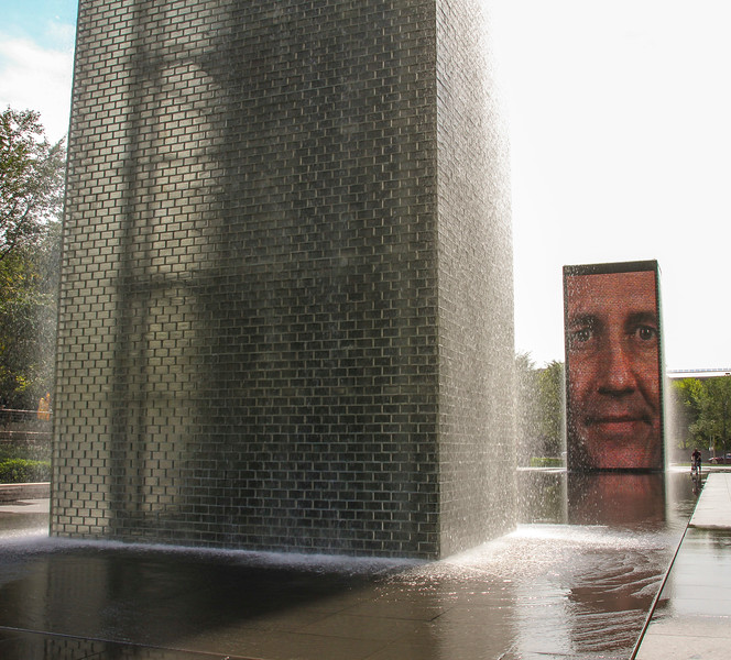 The Crown Fountain in Millenium Park is two towers with 300 faces of Chicagoans projected on it. Every now and again, it spurts out water from their mouths