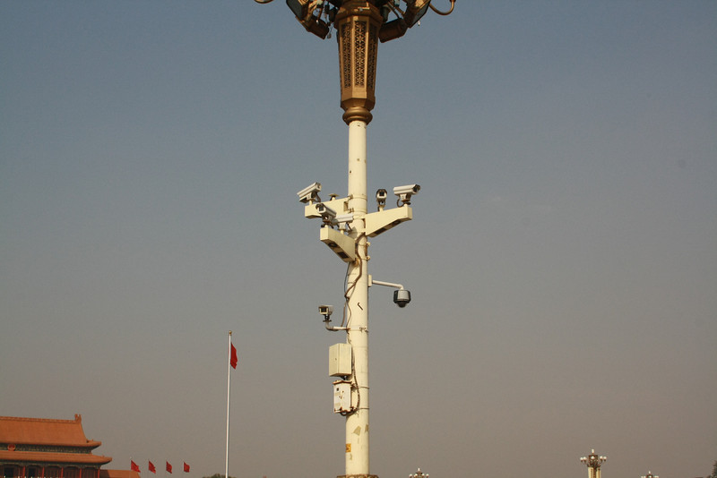 the Beijing pollution seen behind the large number of cameras on this crowd control post.