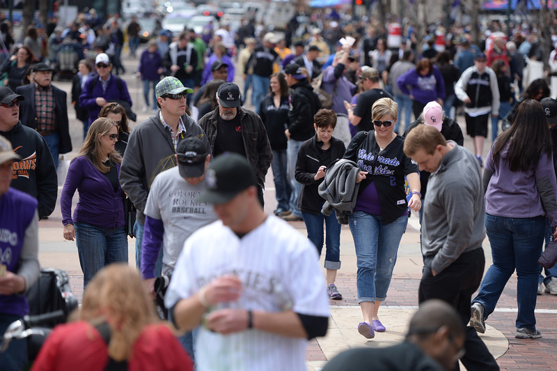 . Rockies fans head into the stadium before the game. The Colorado Rockies hosted the Arizona Diamondbacks in the Rockies season home opener at Coors Field in Denver, Colorado Friday, April 4, 2014. (Photo by Karl Gehring/The Denver Post)