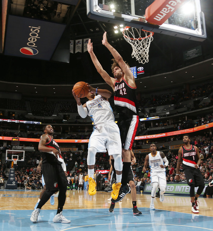. Denver Nuggets guard Randy Foye, front, goes up for a shot as Portland Trail Blazers center Robin Lopez in the fourth quarter of an NBA basketball game in Denver, Tuesday, Feb. 25, 2014. Portland won 100-95. (AP Photo/David Zalubowski)