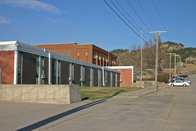 Higbee noted that almost all early-day photographs of the old high school building had Spearfish Mountain as a backdrop.    The original building can be seen lurking behing a more contemporary structure in this photo taken in March 2009.  Nonetheless, it's yet another view with Spearfish Mountain in the background!  As noted above, we'd appreciate hearing  from anyone who could provide us with early-day photographs of Spearfish High School.  Simply drop us an e-mail.  Many thanks!