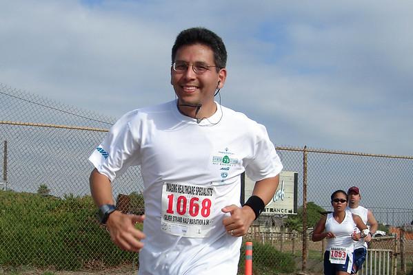 I round the final corner of my first half marathon (photo by Pete)