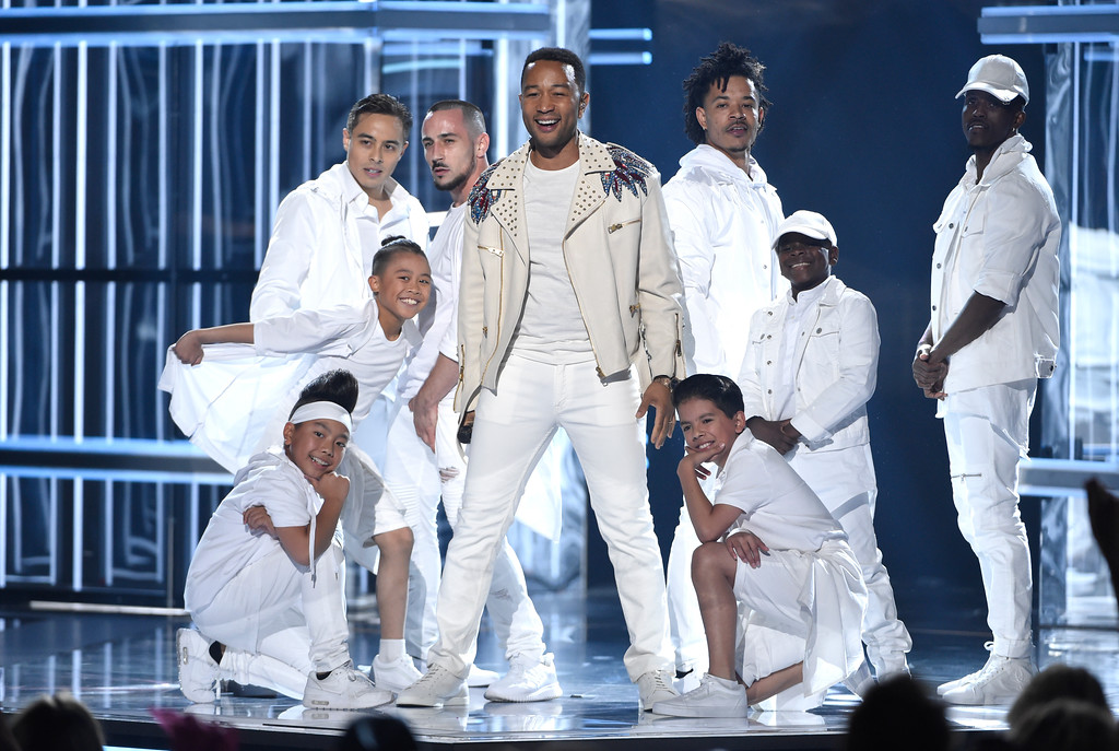 """. John Legend performs \""""A Good Night\"""" at the Billboard Music Awards at the MGM Grand Garden Arena on Sunday, May 20, 2018, in Las Vegas. (Photo by Chris Pizzello/Invision/AP)"""