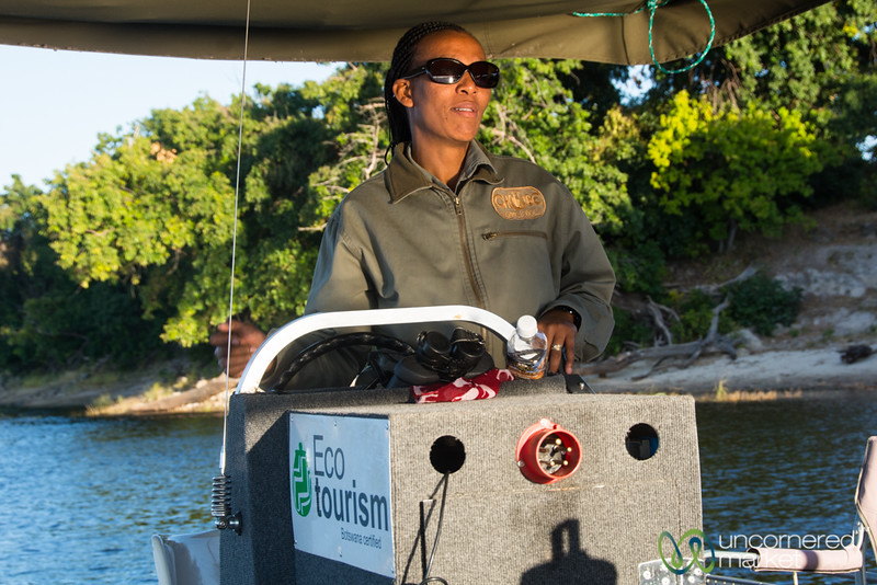 Lynn, our Guide, Driving the Electric Boat - Chobe Game Lodge, Botswana