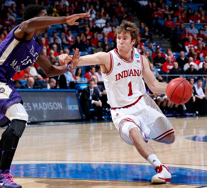 . DAYTON, OH - MARCH 22: Jordan Hulls #1 of the Indiana Hoosiers handles the ball against Andre Nation #15 of the James Madison Dukes in the second half during the second round of the 2013 NCAA Men\'s Basketball Tournament at UD Arena on March 22, 2013 in Dayton, Ohio.  (Photo by Joe Robbins/Getty Images)