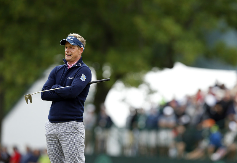. Luke Donald of England reacts to a putt for bogey on the 18th hole during a continuation of Round One of the 113th U.S. Open at Merion Golf Club on June 14, 2013 in Ardmore, Pennsylvania.  (Photo by Scott Halleran/Getty Images)